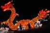 Pengunjung berfoto dengan latar belakang lampion naga pada Festival Lampion Suzhou, di Alun-alun Utara Keraton Kasunanan Solo, Jateng, Sabtu (30/7). Sebanyak sembilan lampion setinggi 12 meter dan berukuran sedang dengan replika Naga, Taj Mahal, Kapal, Shio ditampilkan dalam kegiatan Festival Lampion Suzhou yang diselenggarakan dari tanggal 29 Agustus hingga 21 September mendatang. ANTARA FOTO/ Aloysius Jarot Nugroho/ed/mes/14
