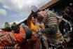 Masyarakat berebut air sisa jamasan kereta (mencuci kereta) Kanjeng Nyai Jimat di Museum Kereta Kraton Yogyakarta, Selasa (28/10). Kereta yang dijamas adalah 2 kereta dari 23 kereta koleksi Kraton Yogyakarta, yakni Kereta Kanjeng Nyai Jimat dan Kereta Kanjeng Kyai Wimono Putro, dimana air serta kain sisa jamasan kereta dalam tradisi yang berlangsung setiap bulan Muharram tersebut mejadi rebutan masyarakat. ANTARA FOTO/Noveradika/Rei/Spt/14.