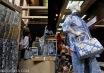Pengunjung mengamati batik indigo dalam Pameran Batik Warisan Budaya VII di Kementerian Perindustrian, Jakarta, Selasa (30/9). Pameran yang berlangsung hingga 3 Oktober 2014 itu menampilkan karya batik asal Yogyakarta, Solo, Bandung, Cirebon, Pekalongan, dan Madura. ANTARA FOTO/Puspa Perwitasari/ama/14