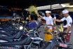 Beberapa anggota Brimob yang juga Umat Hindu memercikkan air suci (tirta) ke sejumlah kendaraan dinas saat persembahyangan Hari Tumpek Landep di Markas Brimob Polda Bali, Denpasar, Sabtu (18/10). Hari Tumpek Landep merupakan hari khusus untuk mengupacarai persenjataan/peralatan untuk memohon kekuatan iman dan mental yang baik dalam penggunaan persenjataan serta peralatan yang sifatnya tajam. ANTARA FOTO/Wira Suryantala/nym/Koz/Spt/14.